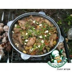 Свиные ребрышки, тушенные с овощами
