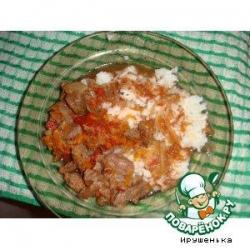 Говядина в горшочке с томатами