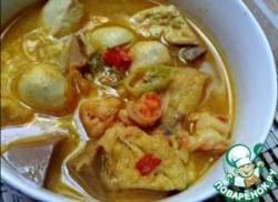 Морепродукты, тофу и джекфрут в кокосовом соусе «Почти карри»